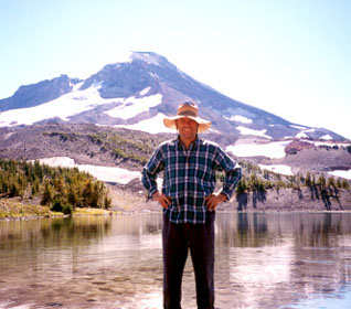 Chris Maser standing in front of a Mountain
